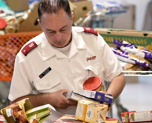 Officer sorting dry food items