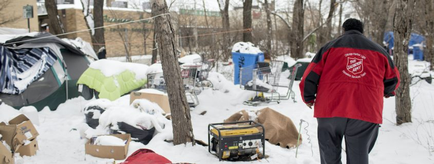 Homeless tent in winter snow
